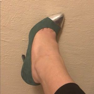 Green shoes with metallic tip